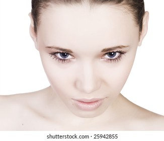 close up view of woman face on a white