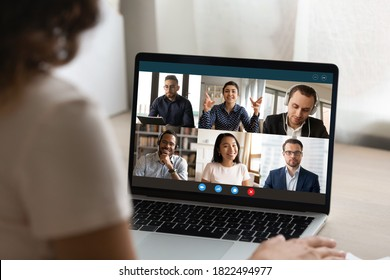 Close up view of woman talk on video call on laptop with diverse multiracial colleagues. Female employee have webcam conference or digital virtual communication with coworker. Online meeting concept. - Shutterstock ID 1822494977