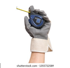 Close up view of Worker Man Hand holding Tape-measure. Male Hand wearing Working Glove with Tools. Human hand, isolated on white background.