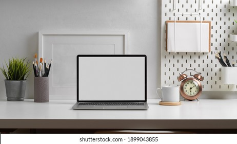 Close up view of worktable with laptop, stationery and decorations in home office room, clipping path