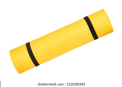 Close up view of yellow yoga mat for exercise, isolated on white background