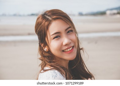 Close up view of young asian girl at the beach.