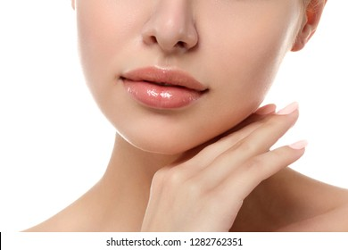 Close up view of young beautiful caucasian woman touching her face isolated over white background. Lips contouring, SPA therapy, skincare, cosmetology and plastic surgery concept