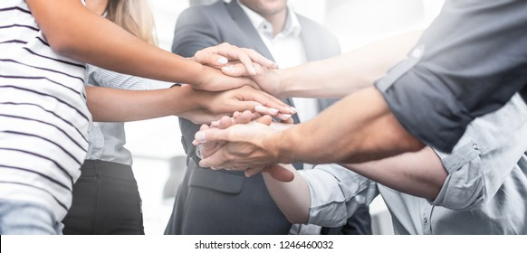 Close up view of young business people putting their hands together. Stack of hands. Unity and teamwork concept. - Shutterstock ID 1246460032