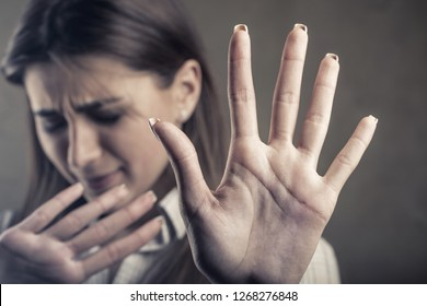 Close up view of young woman making stop gesture with her hand. Focus on the hand