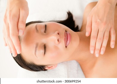 Close up view of a young woman receiving alternative therapy at health spa