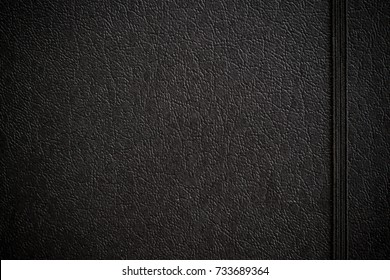 Close up vintage of black leather notebook texture background use for your texts display