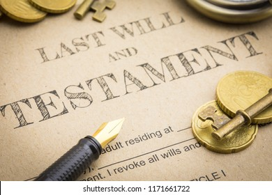 Close up Vintage of Black pen, Gold coins money, Vintage gold key and vintage clock on Last will and testament document concept