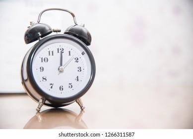 Close up Vintage clock on blurred background.