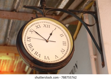 Close up of vintage death clock hang on the vintage zinc roof at vintage train station in province of asia. Clock in train station with copy space for text.