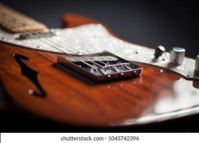 Close up of vintage electric guitar. Musical instrument. Black background