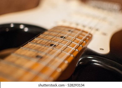 Close up of vintage Fender Stratocaster maple neck and strings