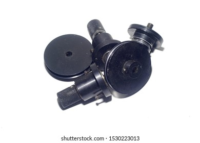 Close up a vintage flywheel shaft motor for drive a film Magazine.