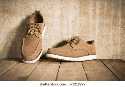 Close up vintage leather shoes man accessory. Men's casual outfits with accessories on rustic wood background.