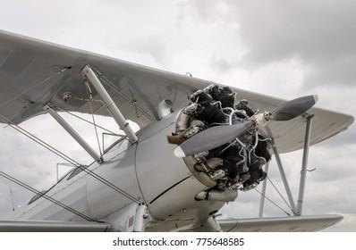 Close up of a vintage multi cylinder radial propeller engine biplane