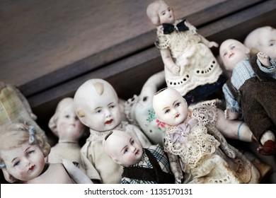 Close up of vintage porcelain dolls in a flea market