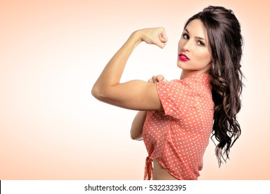 Close up vintage powerful confident pin up girl strong flexing muscle fitness exercise motivation