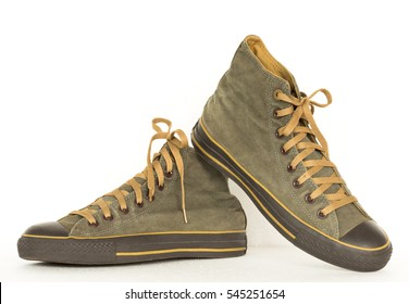 close up vintage style of sport green sneaker shoes on white background
