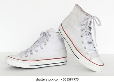 close up vintage style of sport white sneaker shoes on white background