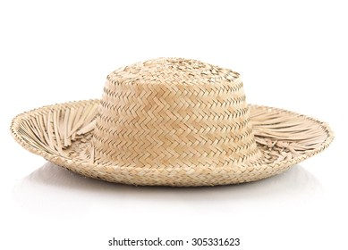 Close up of vintage summer straw hat isolated on white background