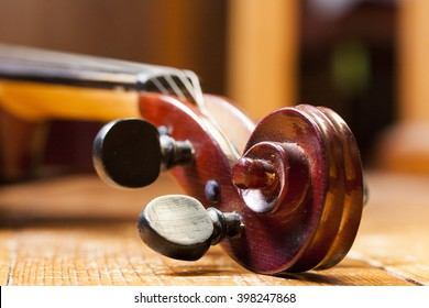 Close up of vintage violin on sheet music background
