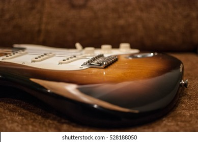 Close up of vintage worn Fender Stratocaster body in sunburst finish