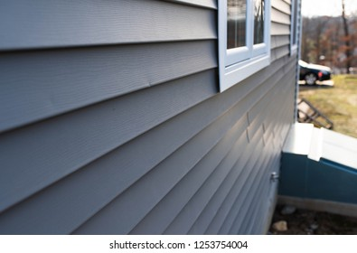 close up of vinyl siding on property development; real estate background