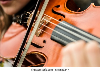 Close up of viola violin being played vibrant cherry wood