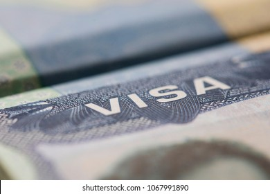 Close up of a Visa spamp in a passport. Immigration and emigration concept
