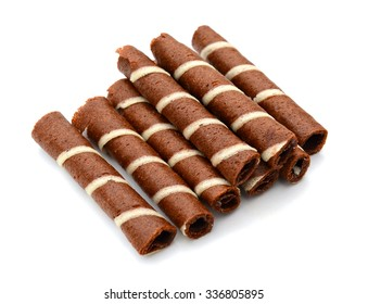 close up of wafer stick pile on white background