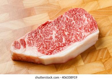 Close up wagyu beef striploin steak on cutting board