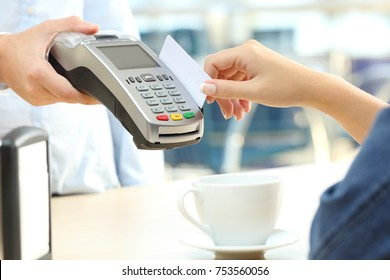 Close up of a waiter hand charging with credit card reader to a customer in a bar terrace