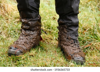 Close up of walking boots. Man, male hiker wearing muddy hiking boots and waterproof gaiters in Wales, UK - Shutterstock ID 1936365733