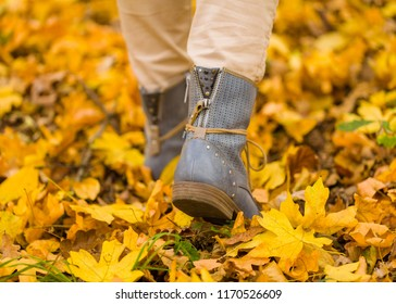 Close up of walking feet on the autumn ground for the school starting.