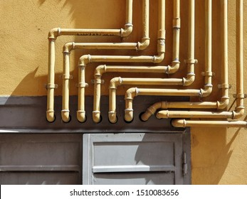Close up of a wall with gas pipes
