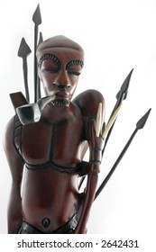 Close up from warrior with spears and pipe from wood from Africa