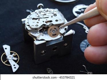 close up of watchmaker desktop assembling  A vintage Mechanical Watch
