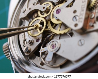 close up of watchmaker repairing a vintage watch