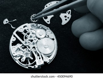 close up of watchmaker working on vintage Watch.