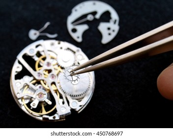 close up of watchmaker Working On A vintage Mechanical Watch.