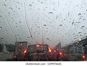 close up water drop on car window at bad trafic