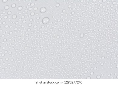 Close up water drops on black tone background. Abstract white gray wet texture with bubbles on plastic PVC surface or grunge. Realistic pure water droplets condensed. Detail of canvas leather texture