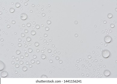 Close up of water drops on black tone background. Abstract gray wet texture with bubbles on plastic PVC surface or grunge. Realistic pure water droplets condensed. Detail of canvas leather texture