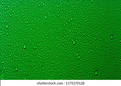 Close up water drops on deep green tone background. Abstarct viridian wet texture with bubbles on window glass surface. Raindrop, Realistic pure water droplets condensed for creative banner design