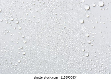 Close up of water drops on gray tone background. Abstarct black wet texture with bubbles on window glass surface or grunge. Raindrop, Realistic pure water droplets condensed for creative banner design