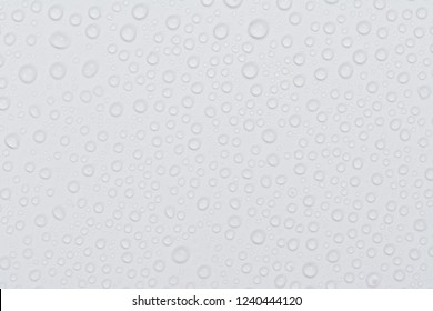 Close up of water drops on gray tone background. Abstract white wet texture with bubbles on plastic PVC surface or grunge. Realistic pure water droplets condensed. Detail of canvas leather texture