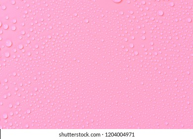 Close up of water drops on rose pink tone background. Abstarct purple wet texture with bubbles on window glass surface. Raindrop, Realistic pure water droplets condensed for creative banner design.
