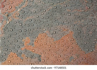 Close up of water drops on slate pattern background