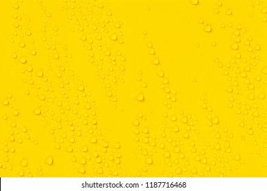 Close up water drops on yellow tone background. Abstarct ultramarine wet texture with bubbles on window glass surface. Raindrop, Realistic pure water droplets condensed for creative banner design