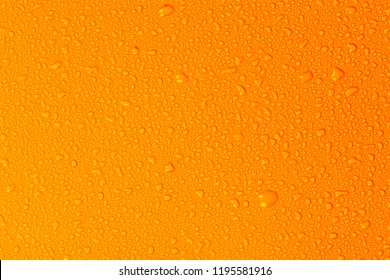 Close up water drops on yellow tone background. Abstarct orange wet texture with bubbles on window glass surface. Raindrop, Realistic pure water droplets condensed for creative banner design, Hot